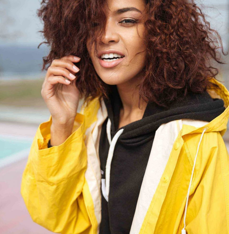 amazing-african-curly-young-woman-wearing-yellow-PCUMRSX-unsplash
