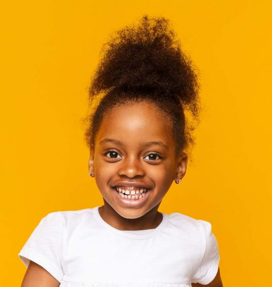 portrait-of-african-little-girl-smiling-over-GXAWB8R