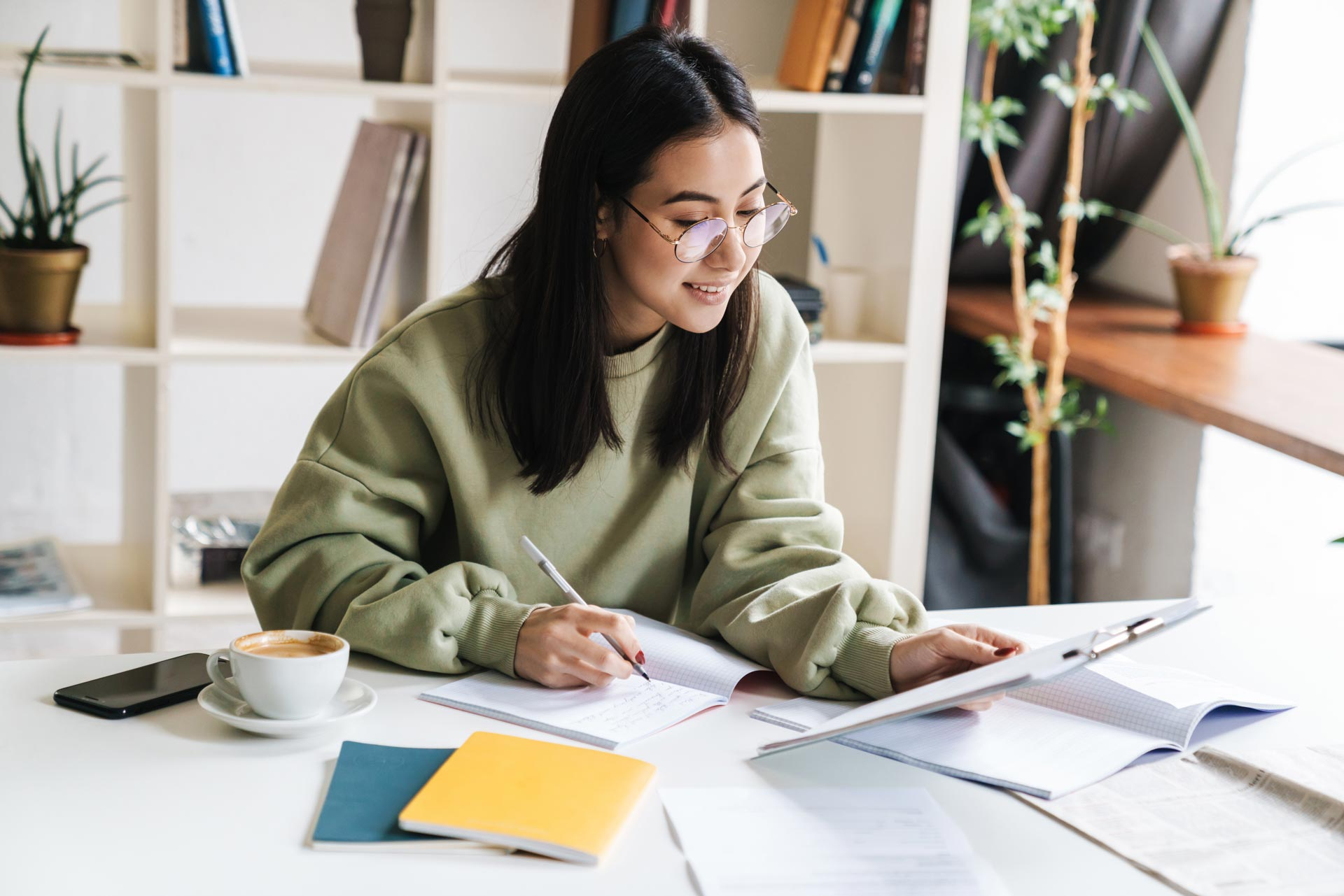 attractive-young-girl-student-studying-at-the-coll-7CLAZTG