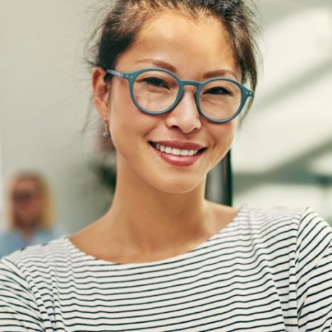 young-asian-businesswoman-smiling-confidently-in-a-4H6MSAK2x
